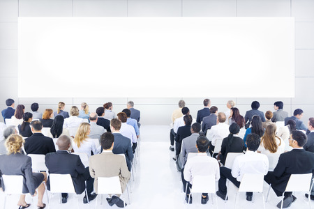 board meeting: Large group of business people in presentation.