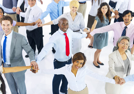 organised group: Large Group of Business People Holding Hand Stock Photo