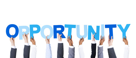 Business People Arms Raised and Holding the Word Opportunity