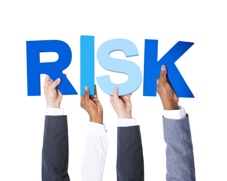 ideas risk: Multiethnic Business People Holding the Word Risk