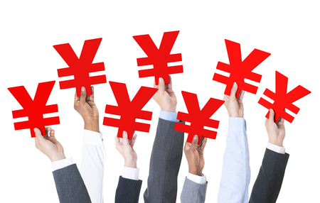 yen sign: Business people holding yen sign. Stock Photo