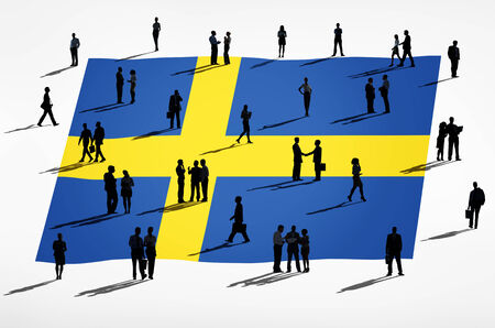 Swedish flag and a group of business people. photo
