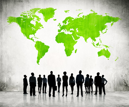 global networking: Business People Standing Individually And A Green Cartography Of The World Above.