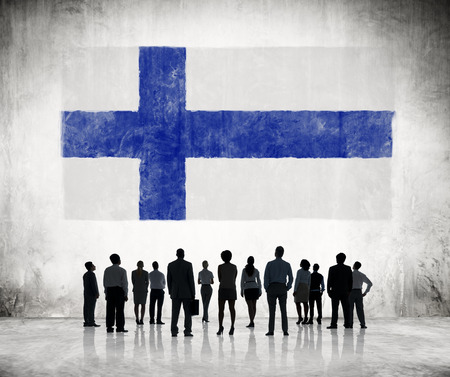 suomi: Silhouettes of Business People Looking at the Finnish Flag