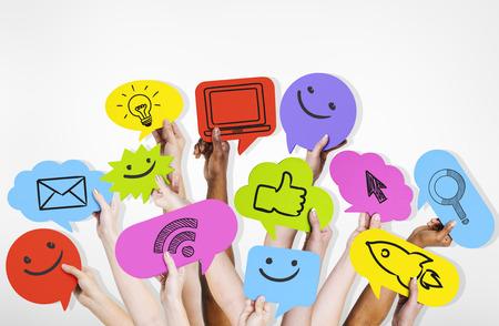 muti: Hands holding social media icons. Stock Photo