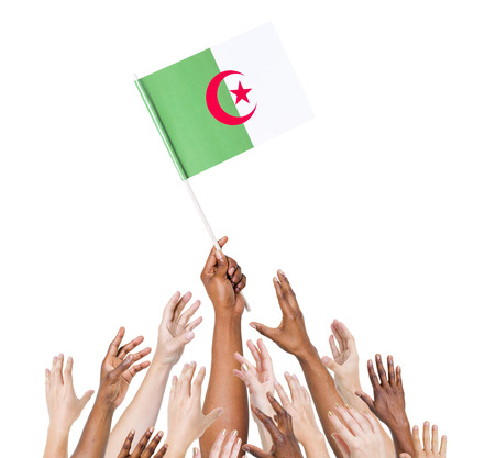 algerian flag: Group of people reaching for and holding the Algerian flag.