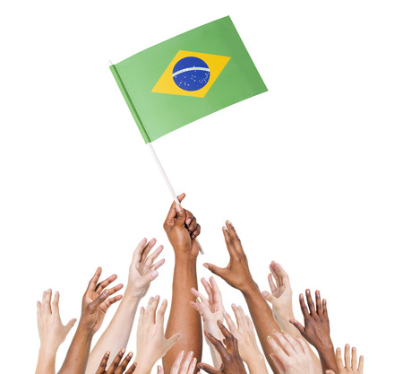 lia: Human hand holding Brazil Flag among multi-ethnic group of peoples hand Stock Photo