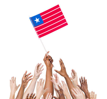 raise the white flag: Group of multi-ethnic people reaching for and holding the flag of Liberia. Stock Photo