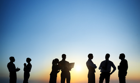 Group Of Business People Silhouettes Working Outdoors And A Copy Space Above