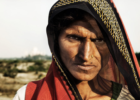 Indigenous Indian woman looking at the camera unhappily. photo