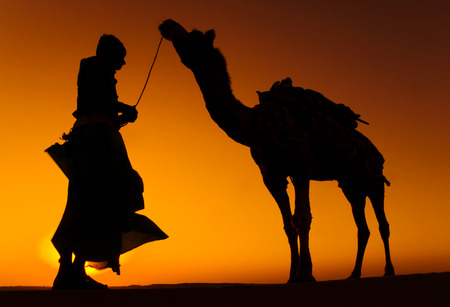 Indigenous Indian man with his camel. photo