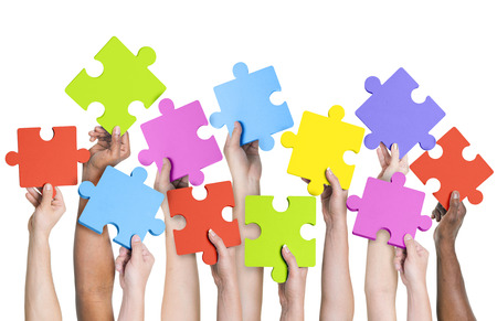 participate: Human hands holding jigsaw puzzle.