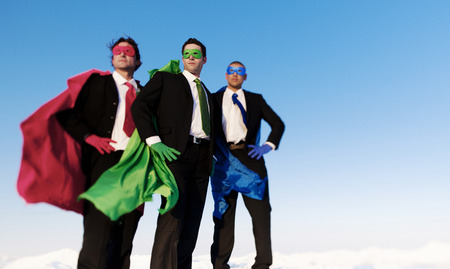 heros: Business superhero posing unanimaously and looking away from the camera. Stock Photo