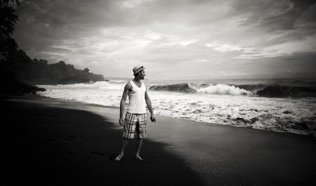 spattering: Man watching power of the ocean.
