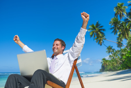 Businessman relaxing on the beach. Stock Photo