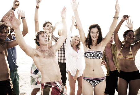 beach party: Group of people enjoying a summer beach party. Stock Photo
