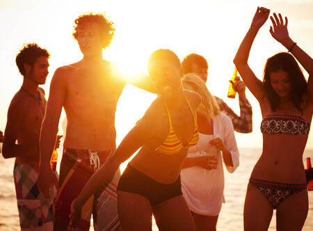 Young people enjoying a summer beach party. photo