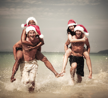 Two couple celebrating on the beach. photo