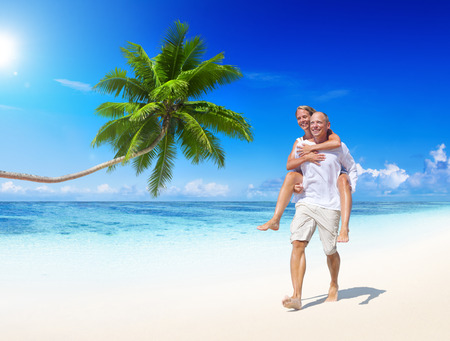 A couple walking on the beach. photo