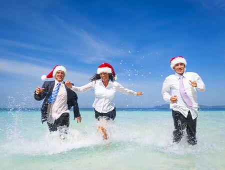Office worker having Fun on the beach on Christmas photo