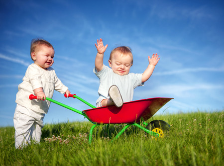 english ethnicity: Twin babies playing together.