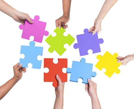 puzzle people: Human hands holding jigsaw puzzle.