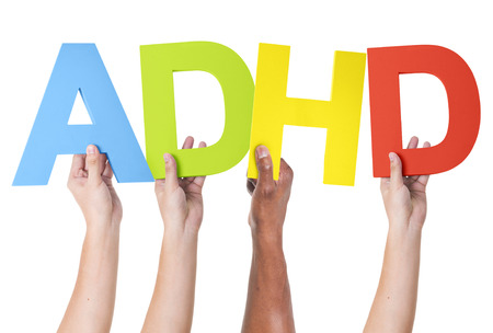 health and healthcare: Multiethnic Arms Raised Holding ADHD
