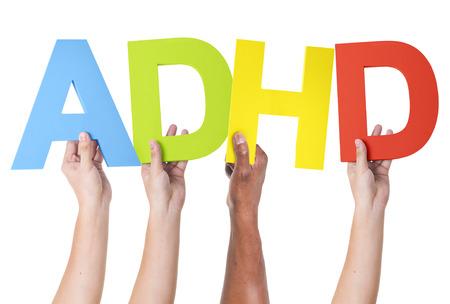 hyperactivity: Multiethnic Arms Raised Holding ADHD