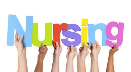 Multi-etnische groep van de Holding van Handen Nursing Stockfoto
