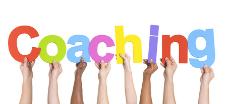 Diverse Hands Holding The Word Coaching photo