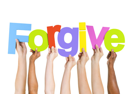 Multi-Ethnic Group of Diverse People Holding Letters To Form A Forgive photo