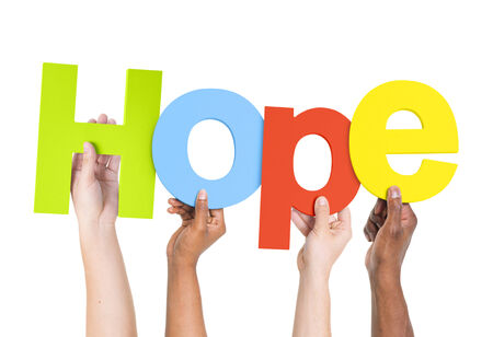 hope: Multi-Ethnic Group Of People Holding The Word Hope