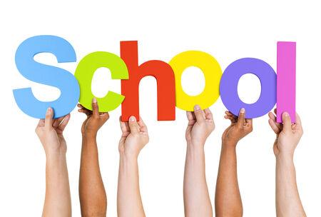 school children uniform: Multi Ethnic People Holding The Word School Stock Photo