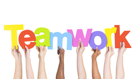 social work: Multi-Ethnic Group Of People Holding The Word Teamwork