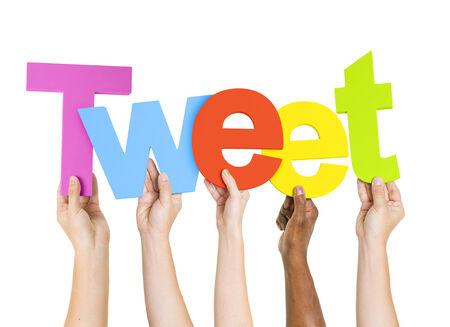 tweet: Multi-Ethnic Group Of People Holding The Word Tweet