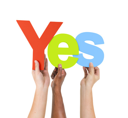 yes: Multi Ethnic People Holding The Word Yes Stock Photo
