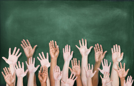 diverse hands: Multiethnic Group of Hands Raised with Blackboard  Stock Photo