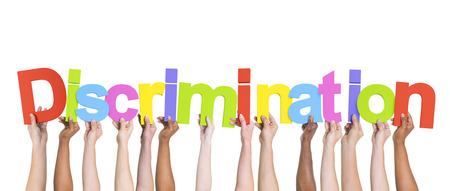 sex discrimination: Diverse Hands Holding the Word Discrimination