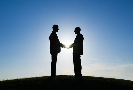 Two Businessmen handshaked for agreement photo