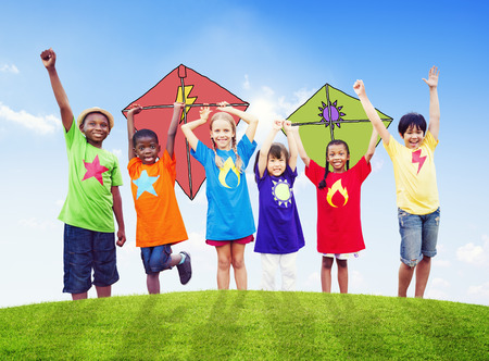 Group of Children Playing Kites Outdoors photo