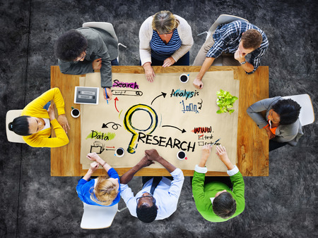 marketing: Multi-Ethnic Group of People in a Meeting and Research Concept
