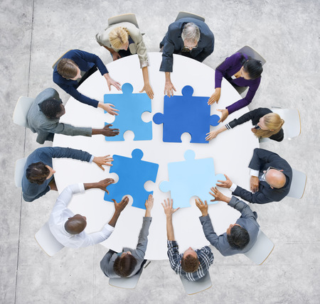 Business People and Jigsaw Puzzle Pieces photo