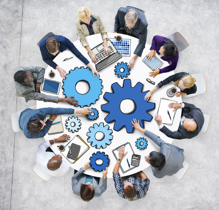 coordination: Group of Business People in Meeting Photo and Illustration