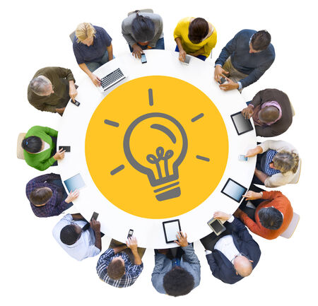 Multiethnic People Using Digital Devices with Light Bulb Symbol photo