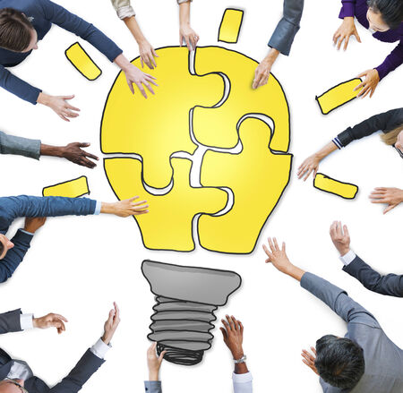 Business People Forming a Light Bulb Puzzle photo