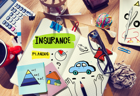 estate planning: Note Pad and Insurance Concept