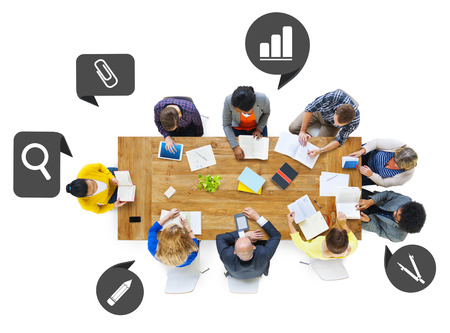 Group of Business People in a Meeting with Speech Bubbles photo