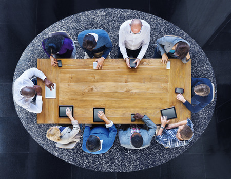 diverse people: Group of Diverse People in a Table Using Devices Stock Photo