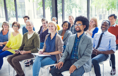 Multi-Ethnic Group of People in Seminar Imagens