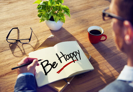 be happy: Businessman Writing the Words Be Happy